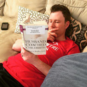 My husband, working on homework from our course.