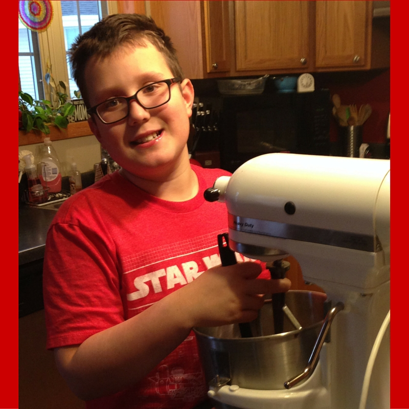 "Ethan and ""Sir-Mix-A-Lot"" (yep, I named my mixer) make chocolate buttercream frosting."