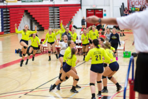 volleyball team celebrating a win