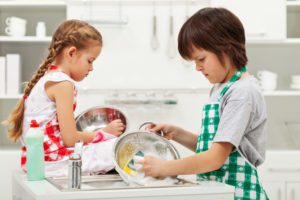 © Nagy-bagoly Ilona | Dreamstime.com - Grumpy kids doing home chores - washing dishes