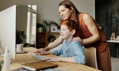 photo-of-woman-teaching-his-son-while-smiling-4145355